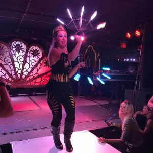 Lady Blaze spinning LED Pyro Tera fans on the runway wearing slit weave custom costume